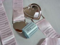 Groeimeter met verzilverd hart en roze en blauw lint